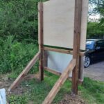 How to assemble a wooden frame to support a free standing outdoors changeable fixtures board for sports club